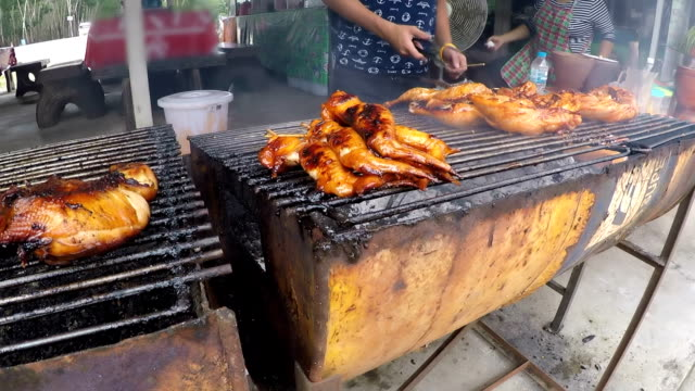 bbq organic chicken on the barbecue grill - grilled chicken stock videos and b-roll footage