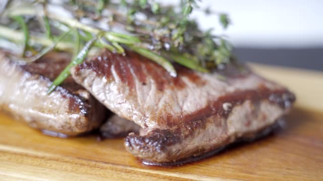 organic cooked steak with rosemary and thyme - ketogenic diet stock videos & royalty-free footage