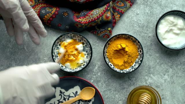 diy organic homemade turmeric face mask recipe - skin care stock videos & royalty-free footage