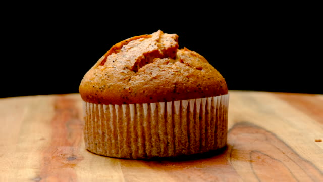 organic lemon and poppy seed muffin - turning stock videos & royalty-free footage