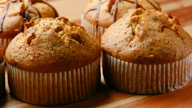 organic lemon and poppy seed muffins - five objects stock videos & royalty-free footage
