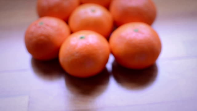 organic tangerines on wooden table - tangerine stock videos and b-roll footage
