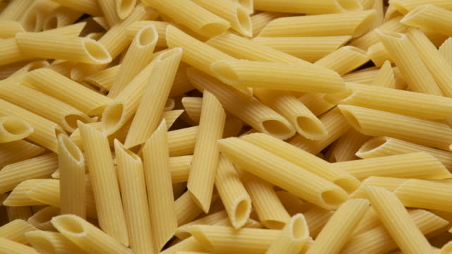organic uncooked italian penne pasta - wholegrain stock videos & royalty-free footage