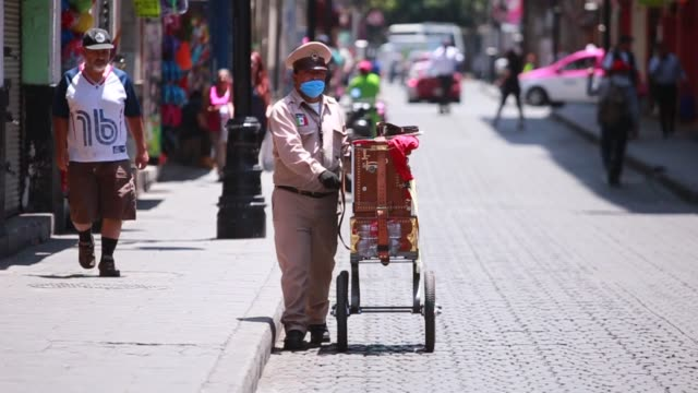 organilleros work while wearing face masks as a preventive measure against the spread of covid19 on march 31 2020 in mexico city mexico the... - mexico stock videos & royalty-free footage