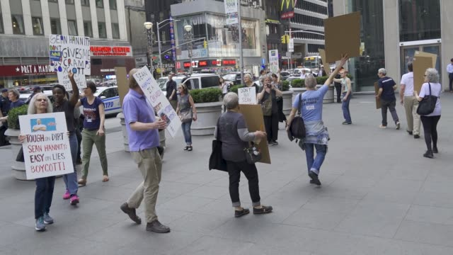 organized by rise and resist nyc. demonstrators rallied in front of the fox news 1211 avenue of the americas building demanding that fox's political... - cable television stock videos & royalty-free footage