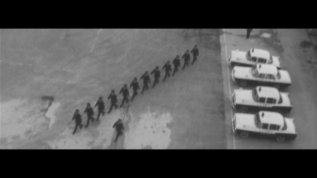 organized violence/kitakyushu police training for dealing with organized violence, judo, running, kanetaro unit, preparing for patrol, patrolling the... - 警察署点の映像素材/bロール