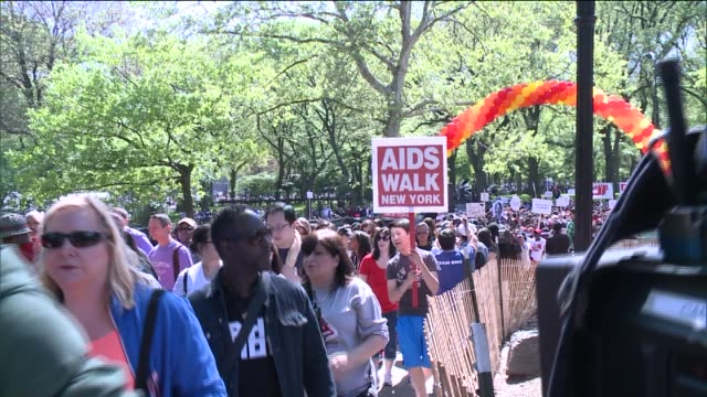 organizers said more than 30-thousand people participated this year and close to $3 million was raised for 40 city organizations helping people... - aids awareness ribbon stock videos & royalty-free footage