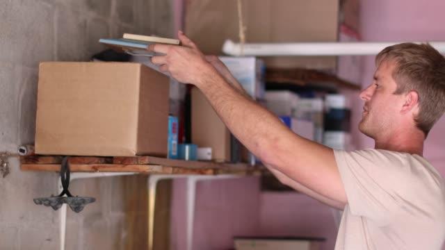 vídeos de stock e filmes b-roll de organizing the garage. - nostalgia