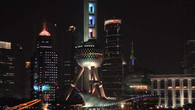 ms oriental pearl tower at night/ zo ws tour boats on huangpu river with pudong in background/ shanghai, china - river huangpu stock videos & royalty-free footage