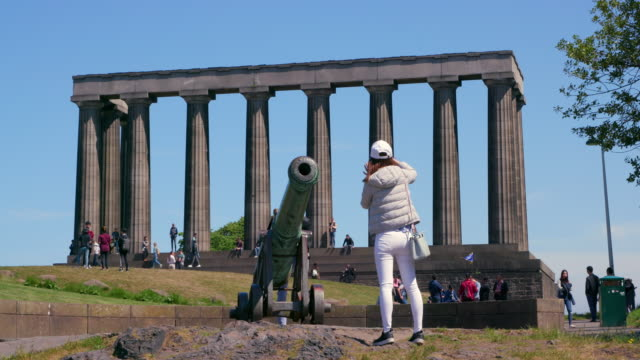 oriental tourist photographs the portugese cannon & national monument of scotland, calton hill, edinburgh, scotland - calton hill national monument stock videos and b-roll footage