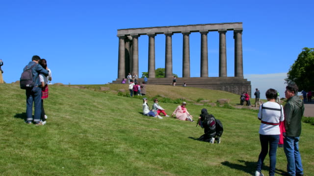 oriental tourists at national monument of scotland, calton hill, edinburgh, scotland - calton hill national monument stock videos and b-roll footage