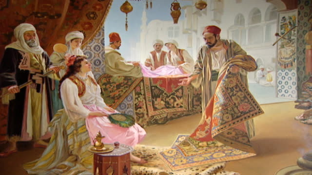 orientalist painting. view of a 19th century painting depicting a levantine carpet merchant showing an oriental rug to a seated lady holding a fan in... - profile stock videos & royalty-free footage