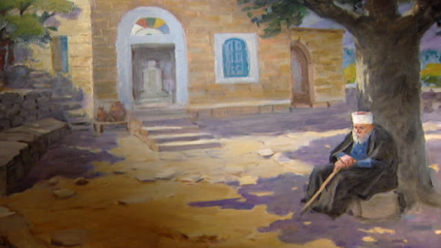 orientalist painting. view of a 19th century painting depicting an old druze sheikh wearing a black abaya sitting under a tree in khalwat al-bayada. - theology stock videos & royalty-free footage