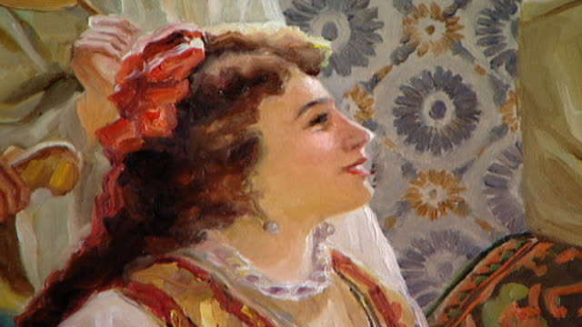 orientalist painting. view of a detail of a 19th century painting depicting a pretty woman's profile. she is wearing a red ribbon and looking up and... - profile stock videos & royalty-free footage