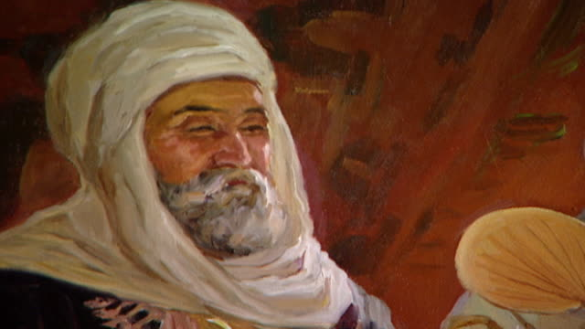 orientalist painting view of a detail of a 19th century painting depicting a smiling bearded arab man wearing a white turban - canvas stock videos & royalty-free footage