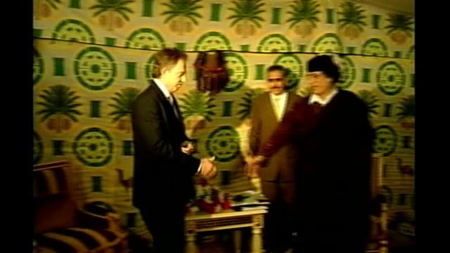 sirte photography*** tony blair mp shaking hands with gaddafi in tent close shot gaddafi - muammar gaddafi stock videos & royalty-free footage