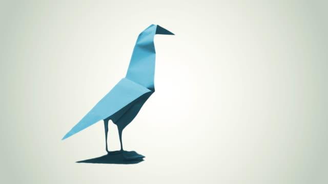 vidéos et rushes de oiseau en origami, 4k - origami