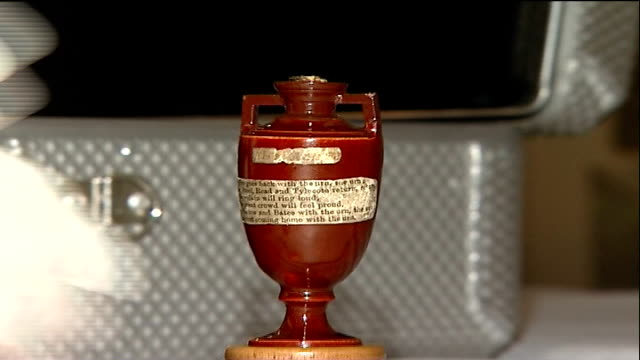 original 'ashes' urn packed up for tour of australia england london lord's cricket ground int **flash photography** original 'ashes' urn being... - tissue paper stock videos and b-roll footage
