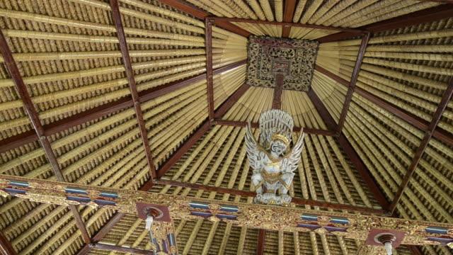 MS Original balinese roof construction of bamboo and Garuda figure / Ubud, Bali, Indonesia