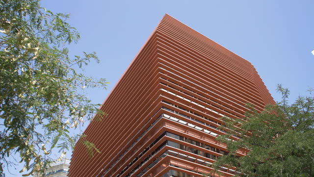 original design orange office corporate building dolly shot at barcelona. cnmv spain stock market - abstract stock videos & royalty-free footage
