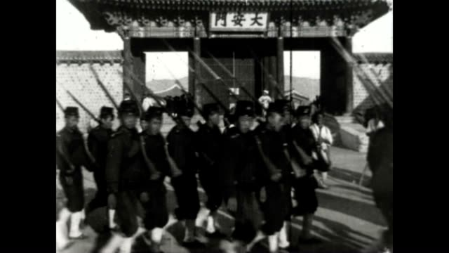 Original film of Daehanmun gate the entrance to Deoksu Palace occupied by Japanese forces Filmed by Burton Holmes on his Korean expedition