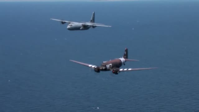 original normandy c47 flys over the beaches and villges it flew over 70 years ago with the help of the 37th airlift squadron's c130 two wwii vets... - d day stock videos & royalty-free footage