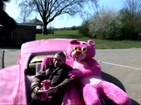 original 'pink panther' car photocall; tracks 1 and 2: partially mute / partially fx england: london: hampstead heath: parliament hill: ext bert... - parliament hill stock videos & royalty-free footage