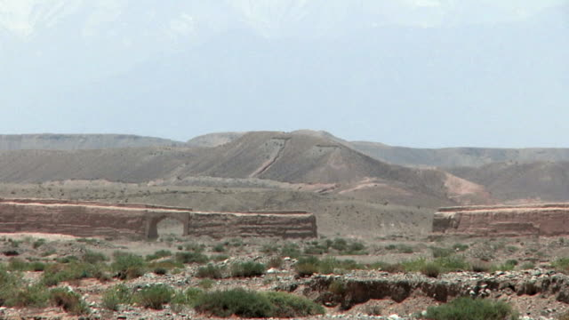 WS Original stretch of Great Wall with arid landscape behind / Jiayuguan, Gansu, China