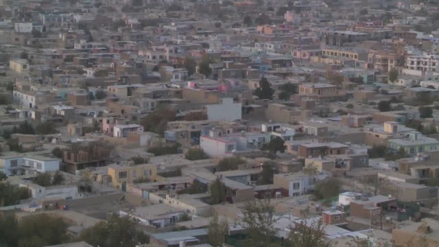 originally designed for half a million inhabitants, afghanistan's sprawling capital city of kabul now houses more than three million people. property... - kabul stock videos & royalty-free footage