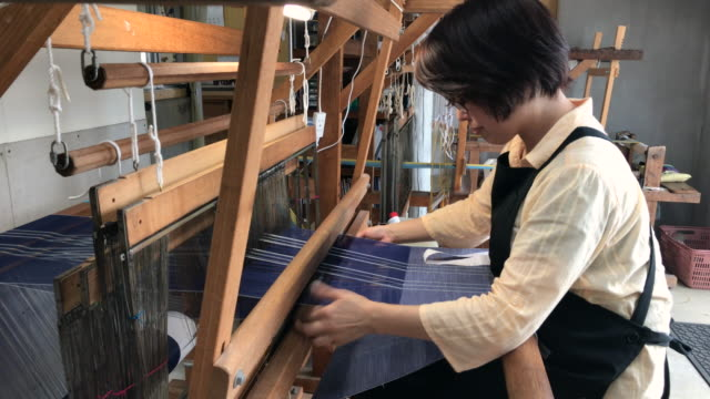 orimono textile shop in okinawa japan - loom stock videos & royalty-free footage