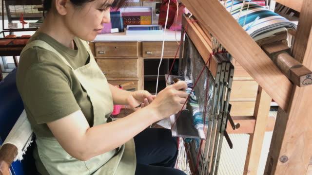 orimono textile shop in okinawa japan - loom stock videos & royalty-free footage