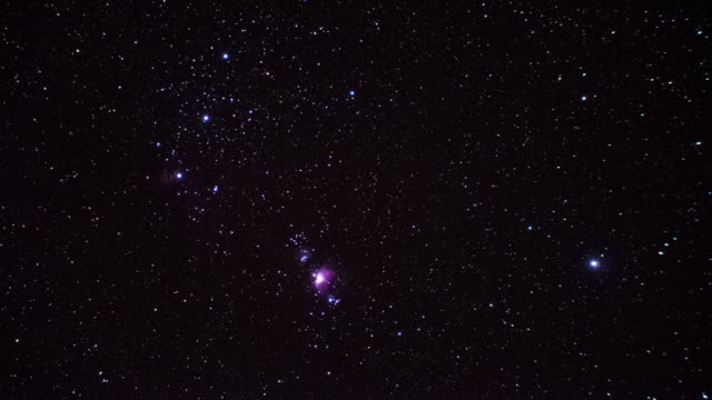 orion and the orion nebula sparkle in the night sky, - constellation stock videos & royalty-free footage