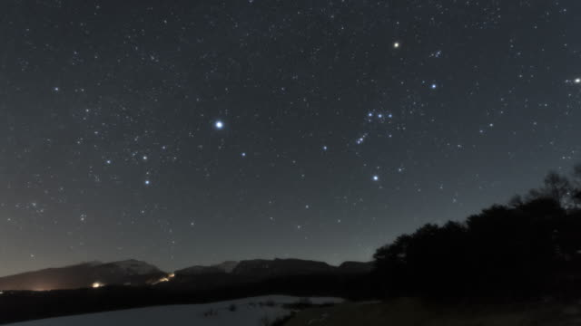 orion setting above the mountains - constellation stock videos & royalty-free footage