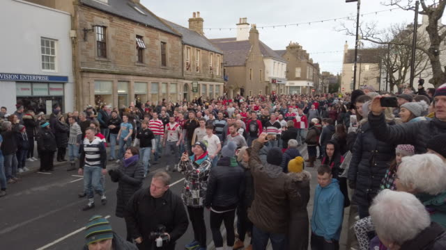 orkadians take part in the new year's ba' game played with a hand crafted leather ball on january 1, 2020 in kirkwall scotland. the ba' game is a... - cultures stock videos & royalty-free footage