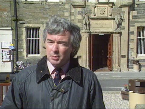 orkney child abuse inquiry; scotland: orkneys: kirkwall: int cms paul lee drinking a cup of tea side lee chatting to another as both sitting at table... - itv news at one stock videos & royalty-free footage