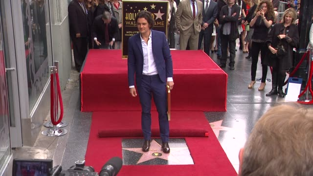 orlando bloom poses with star orlando bloom honored with star on the hollywood walk of fame at hollywood walk of fame on march 02 2014 in hollywood... - 2014 stock videos and b-roll footage