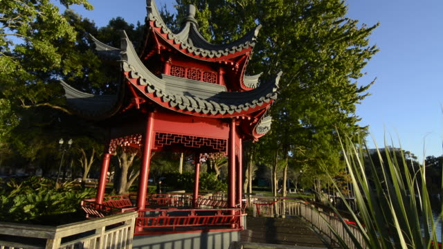 orlando florida lake eola famous chinese structure pagoda on water historical gift from china sister city of guillin red wood called ting - pagoda stock videos & royalty-free footage