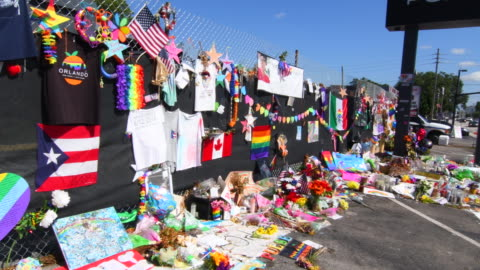 orlando florida pulse night club tragedy shooting memorial at gay bar by terrorist on june 12, 2016 - memorial video stock e b–roll