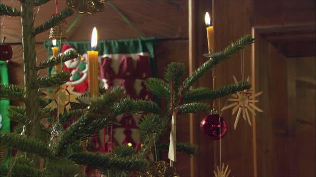 cu td ornaments hanging from christmas tree / near salzburg, austria - twig stock videos and b-roll footage