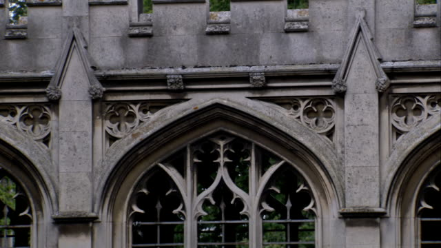 ornate, arched windows characterize the walkway of the bridge of sighs at st. john's college, cambridge. available in hd. - cambridge university stock videos and b-roll footage