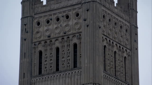 ornate architectural details adorn the steeple of the norwich cathedral. available in hd. - steeple stock videos & royalty-free footage