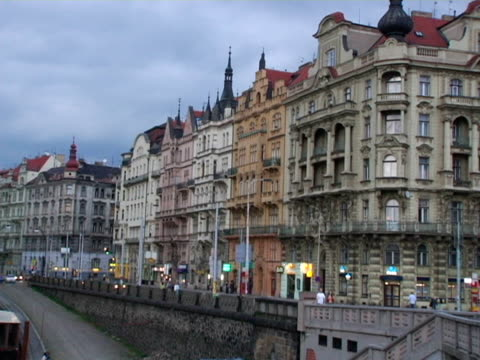 ws, zi, cu, ornate building along river vltava at dusk, prague, czech republic - river vltava stock videos & royalty-free footage