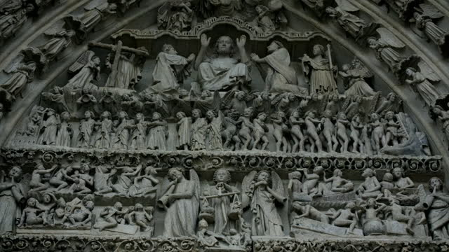 ornate carvings above cathedral entrance, france - cathedral stock videos & royalty-free footage