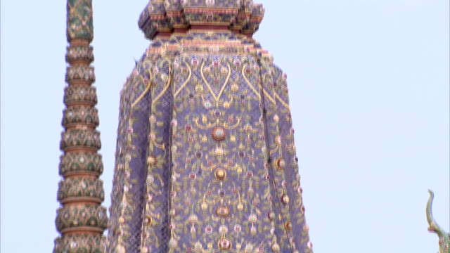 ornate carvings adorn a spire at wat arun. - spire stock videos & royalty-free footage