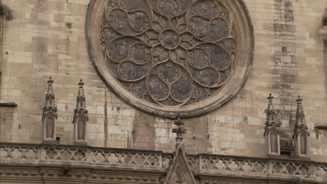 ornate carvings and a rose window shape the exterior of lyon cathedral. - rose window stock videos and b-roll footage
