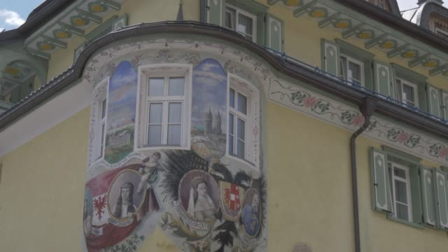 ornate detail on hotel along main road in canazei, fassa valley, province of trento, south tyrol, italian dolomites, italy, europe - canazei video stock e b–roll