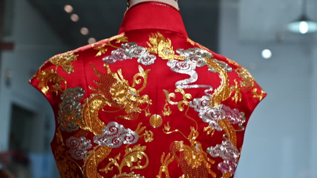 ornate embroidery of dragon on traditional chinese wedding dress - gold dress stock videos & royalty-free footage