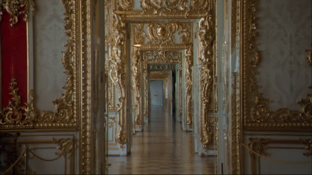 ornate gold-trimmed doors open to reveal a series of  gold-trimmed doorways. - stately home stock videos & royalty-free footage
