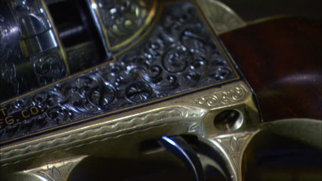 ornate metalwork covers the cylinder of a revolver. - metalwork stock videos & royalty-free footage