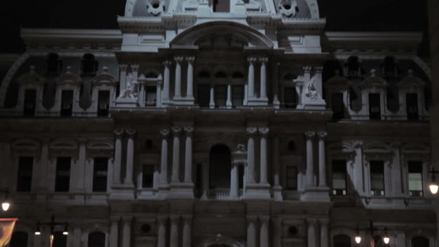 tu ornate multi-story building with dramatic lighting at night - ornate stock videos & royalty-free footage